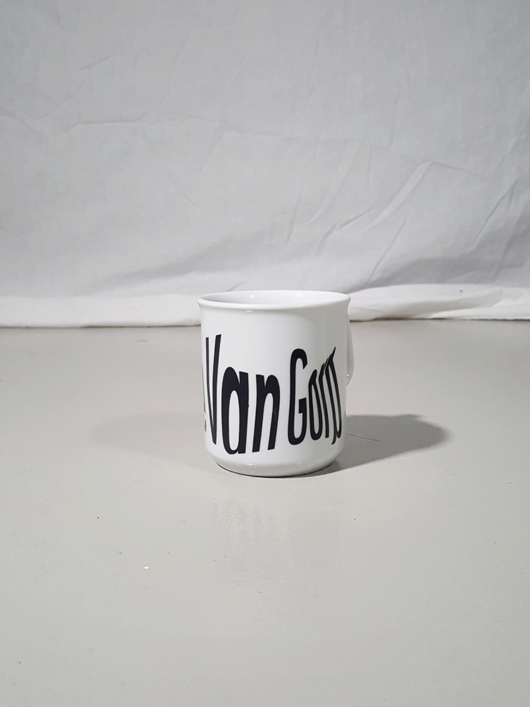 vintage Lieve Van Gorp white coffee mug with distorted logo 174037